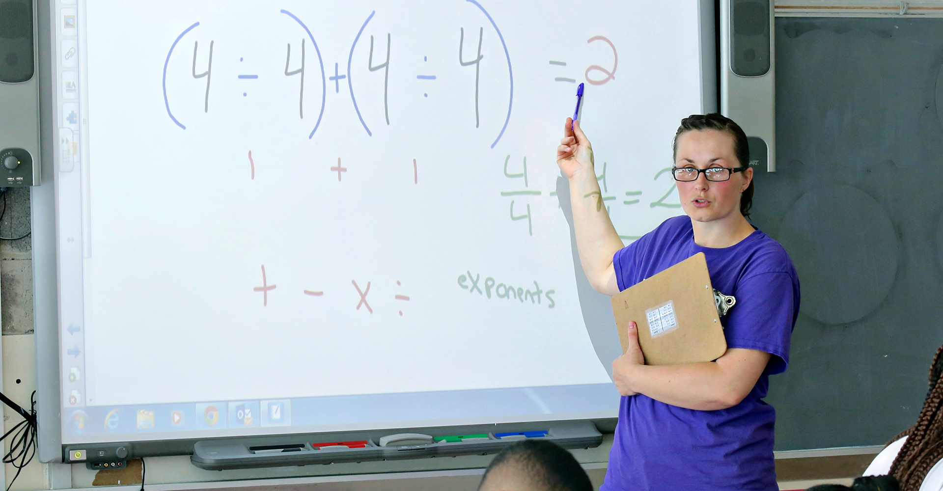 Math teacher education warner graduate programs female teacher explaining a math equation 1betcityfo Image collections