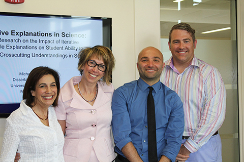 faculty and student pose at end of dissertation defense