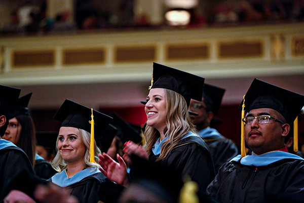 Three graduates look forward to the stage at Warner commencement