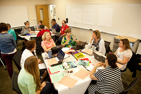 teachers in a classroom attending professional development