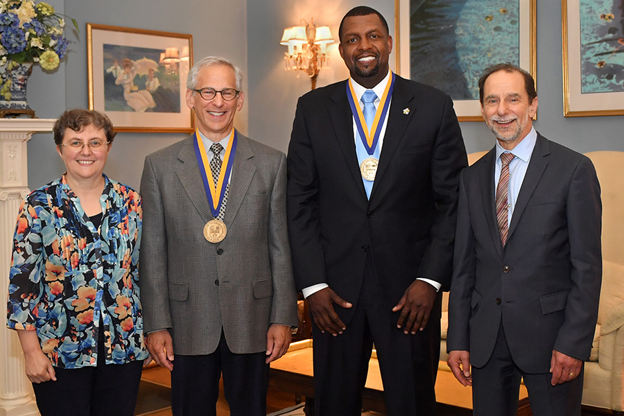 (Pictured, l-r): Dean Raffaella Borasi, Howard Konar, Shaun Nelms, President Richard Feldman