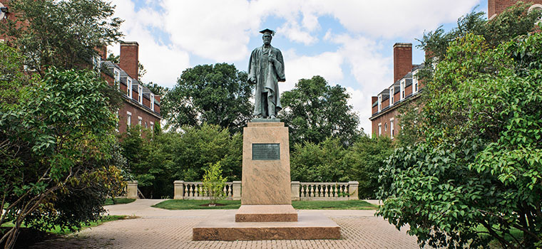 statue on campus of first martin anderson